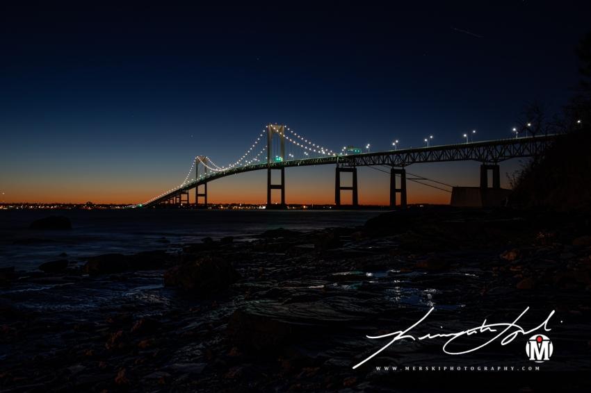 Newport Bridge - High texture of light off of shoreline rocks.